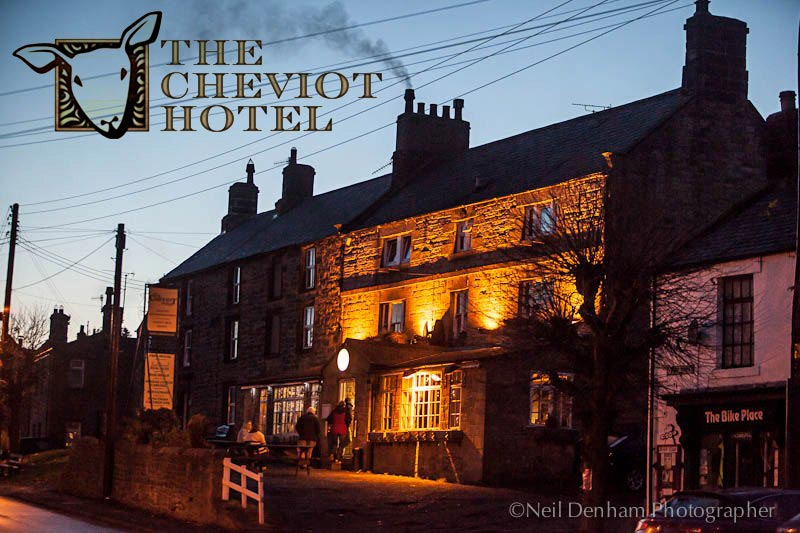 The exterior of The Cheviot Hotel, at night