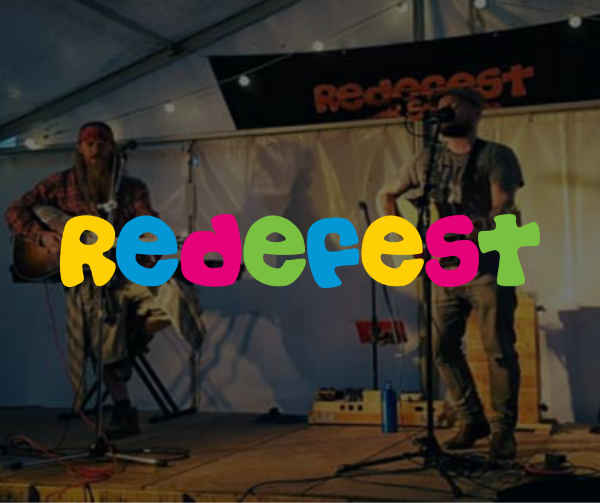 Performers on stage, overlaid with the colourful Redefest logo.